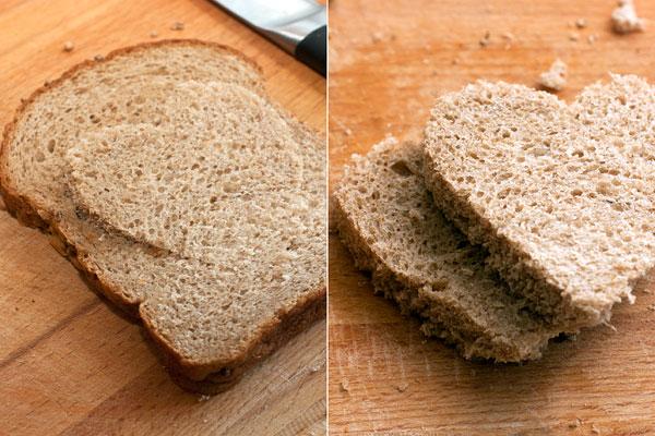 Нарежьте черный хлеб ровными ломтями толщиной 1,5-2 см.  Острым ножом вырежьте в середине окошко в виде сердечка или другой нужной фигуры. Если есть подходящего размера формочки для печенья, используйте их, чтобы упростить работу.